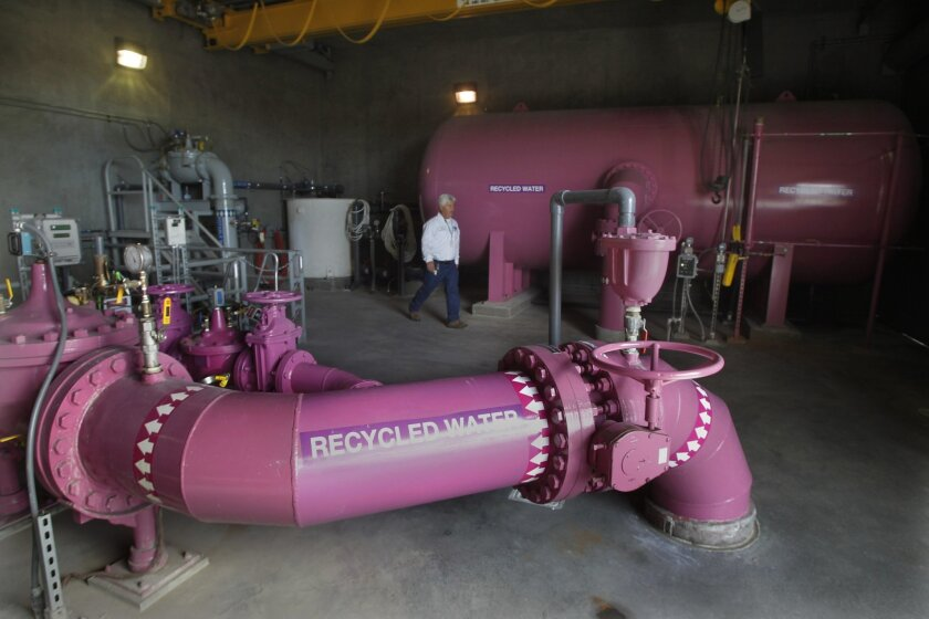 PURPLE POWER -- The distinctive purple color identifies the water from these pipes as recycled for non-potable use. File photo taken Nov. 22, 2013, at Otay Water District's 944 Pump Station at the 680 Reservoir in Chula Vista.