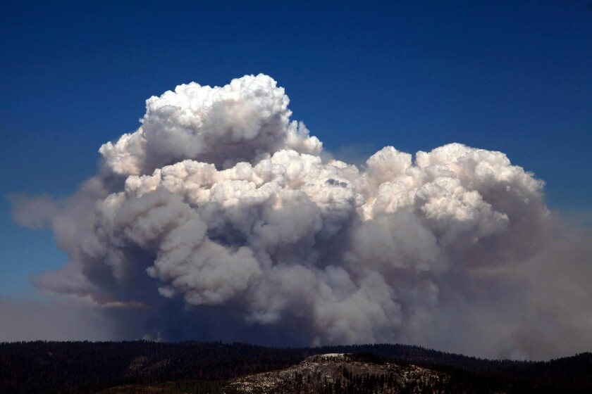 A huge smoke cloud rises into the air in Tuolumne County on Tuesday as the Rim fire continued to rage.