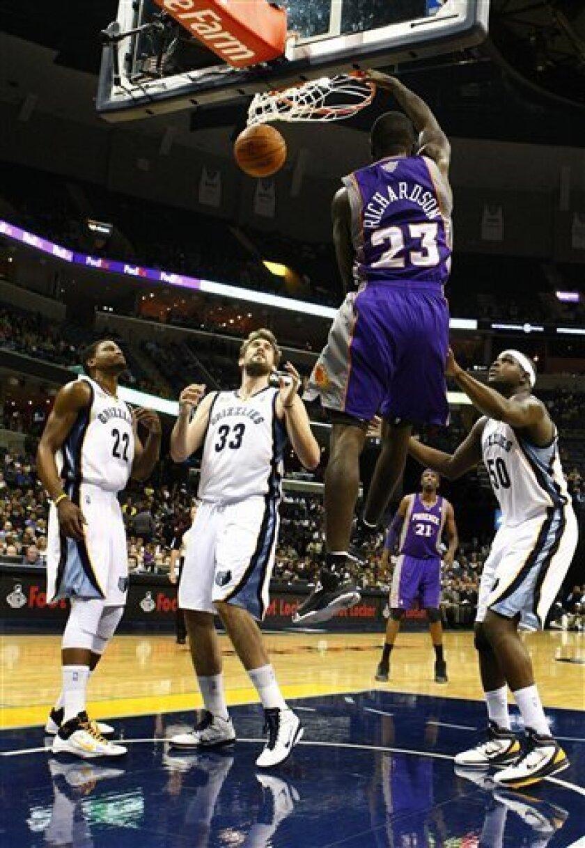 Phoenix Suns' Jason Richardson dunks as Memphis Grizzlies' Rudy Gay; Marc Gasol, of Spain; and Zach Randolph , from left, look on during the first half of an NBA basketball game in Memphis, Tenn., Monday, Nov. 8, 2010. (AP Photo/Mark Weber)
