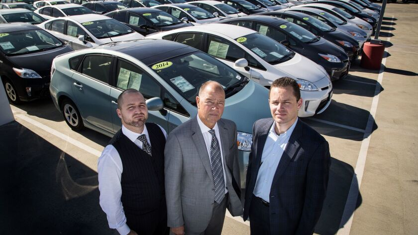 Claremont Toyota refuses to sell these Priuses because it believes a defect can cause them to lose power and stop. Dealer Roger Hogan, who is suing Toyota, is flanked by Roger Hogan Jr., left, and Stephen Hogan. The family owns Claremont Toyota and Capistrano Toyota.