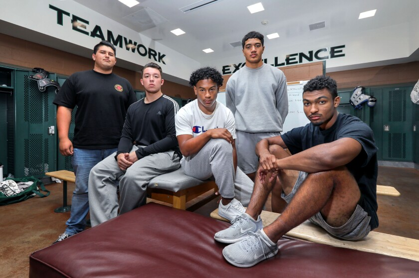 Gathered in the Oceanside football locker room are team leaders (left to right) Moises Ross, Chris Hunter, Kavika Tua, Kiki Laie and Trejan Apodaca. The No. 6-ranked Pirates travel to San Marcos on Friday night to take on No. 8 Mission Hills.