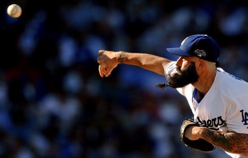 Dodgers reliever Brian Wilson throws against the Cardinals on Oct. 16.