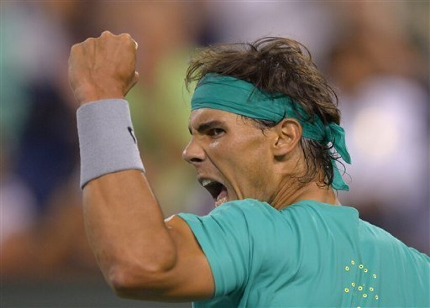 Rafael Nadal, of Spain, reacts after winning a point over Ernests Gulbis, of Latvia, during their match at the BNP Paribas Open tennis tournament, Wednesday, March 13, 2013, in Indian Wells, Calif. (AP Photo/Mark J. Terrill)