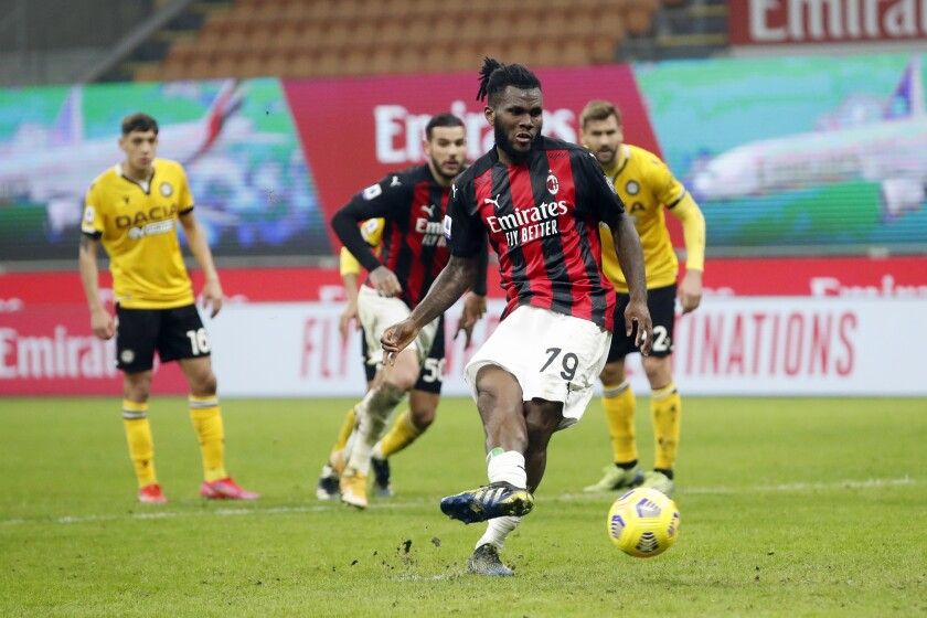 AC Milan midfielder Franck Kessie (79) scores the penalty spot during the Serie A soccer match between AC Milan and Udinese at the San Siro stadium, in Milan, Italy, Wednesday, March 3, 2021. (AP Photo/Antonio Calanni)