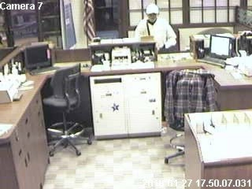 This surveillance images shows the 'Geezer Bandit' on Jan. 27, 2010, robbing San Diego National Bank, 1075 Rosecrans St.