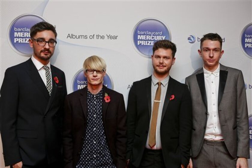 """FILE - In this Nov. 1, 2012 file photo, from left, Gus Unger-Hamilton, Gwil Sainsbury, Joe Newman and Thom Green of Alt-J attend the Barclaycard Mercury Prize 2012 at the Roundhouse, in London.  Their debut album, """"An Awesome Wave,"""" went on to win the prestigious Mercury Prize given to the top albu"""