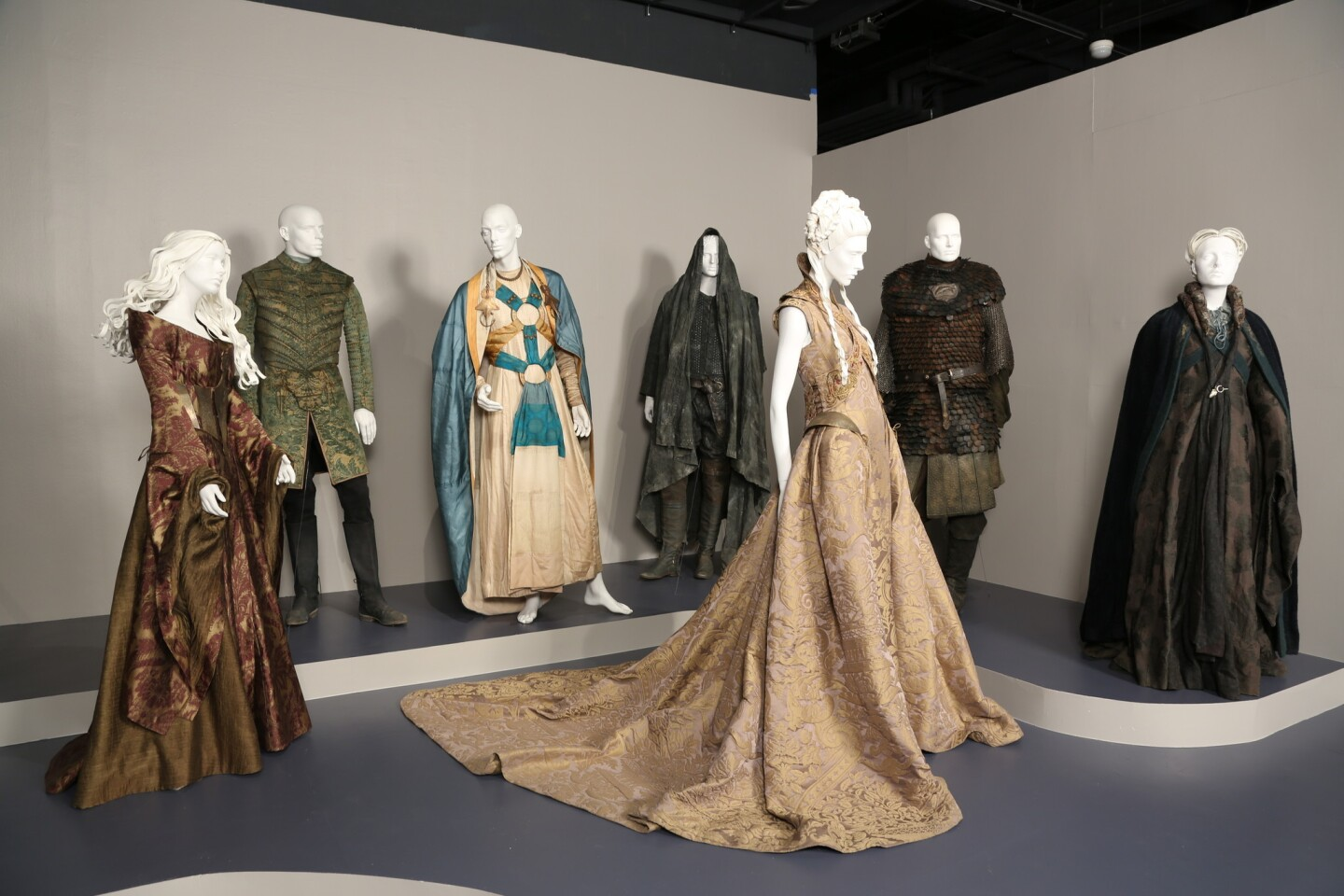 """""""Game of Thrones"""" costumes, designed by Michele Clapton. These costumes, from left, were worn by Lena Heady as Cersei Lannister; Finn Jones as Loras Tyrell; George Georgiou as Razdal mo Eraz; Patrick Malahide as Balon Greyjoy; Sophie Turner as Sansa Stark; Clive Russell as Brynden """"Blackfish"""" Tully, and and Michelle Fairley as Catelyn Stark."""