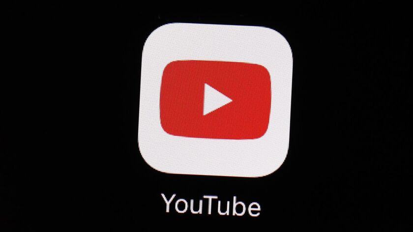 FILE - This March 20, 2018 file photo shows the YouTube app on an iPad in Baltimore. YouTube is upda