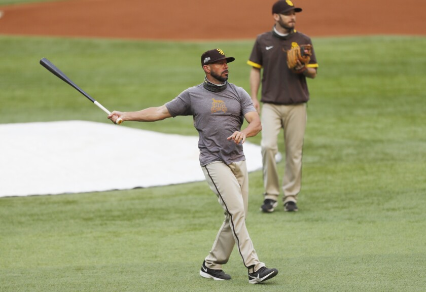 Padres manager Jayce Tingler hits balls during a workout before the NLDS in October.