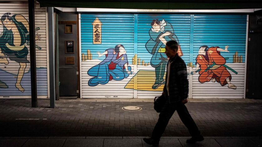 A man walks in a stretch of Tokyo's Asakusa area.