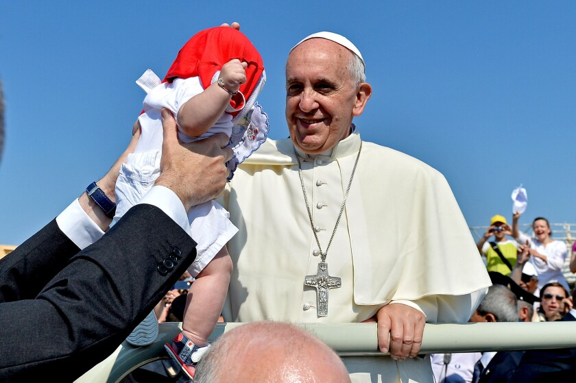 Opinion: Did Pope Francis acquiesce to conservatives on married priests? Sure looks like it