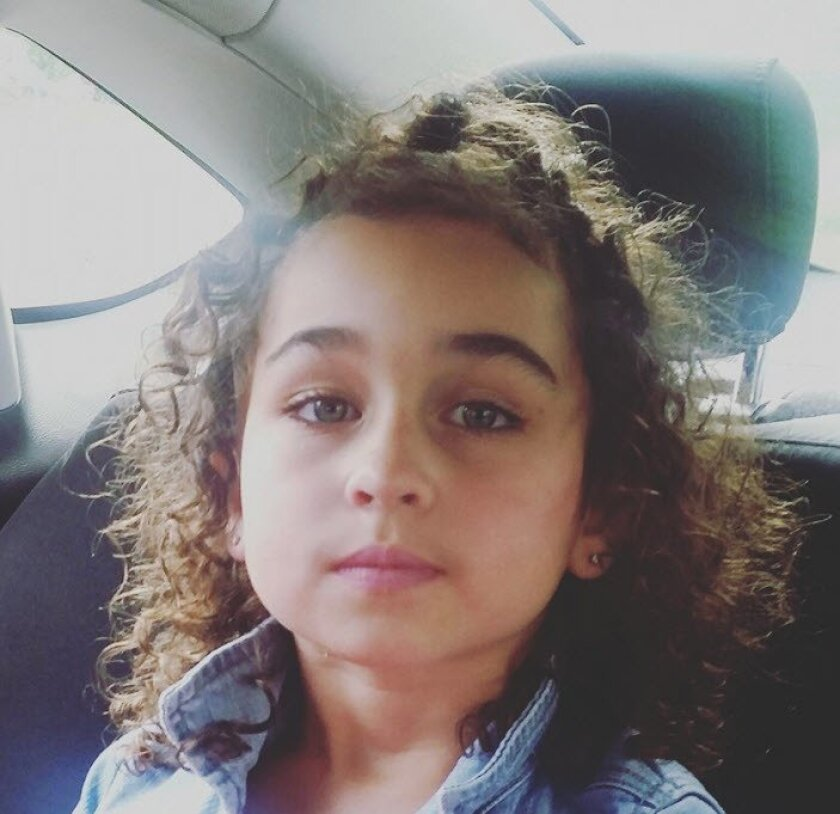 This photo provided by the Calgary Police shows Taliyah Leigh Marsman. Police in Calgary say they have found a body believed to be that of Marsman, reported missing earlier this week after her mother was found dead and a suspect has been charged with murder in both their deaths.  The Calgary Police
