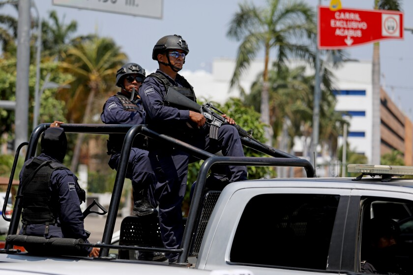 14 police officers killed in an ambush in Mexico, testing president's security strategy