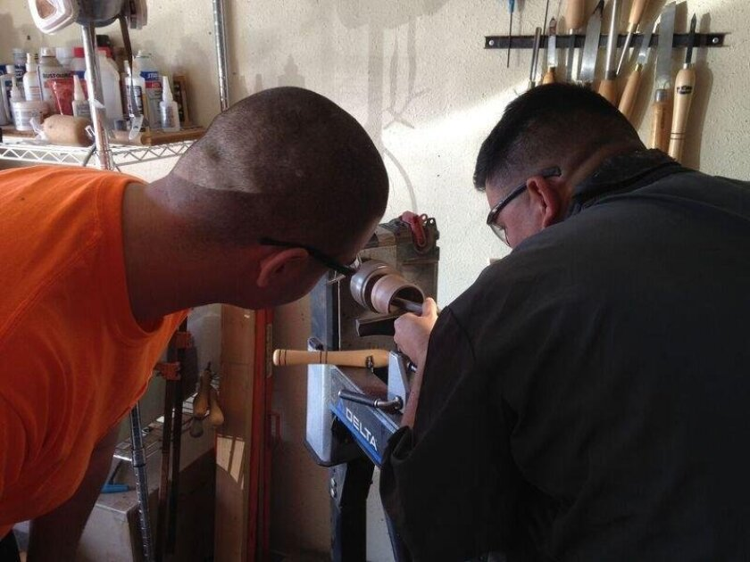 Retired Marine Gunnery Sgt.  Ernesto Aquino is teaching injured comrades woodworking therapy classes.