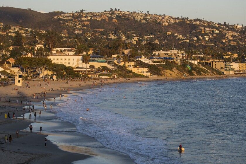 "A Laguna beach staff report says the city is largely built out within its environmental restraints and cites concerns about preserving the city's ""small-scale village character."""