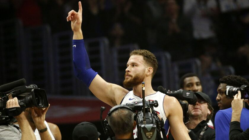 Detroit Pistons' Blake Griffin (23) waves with fans during an NBA basketball game between Los Angele