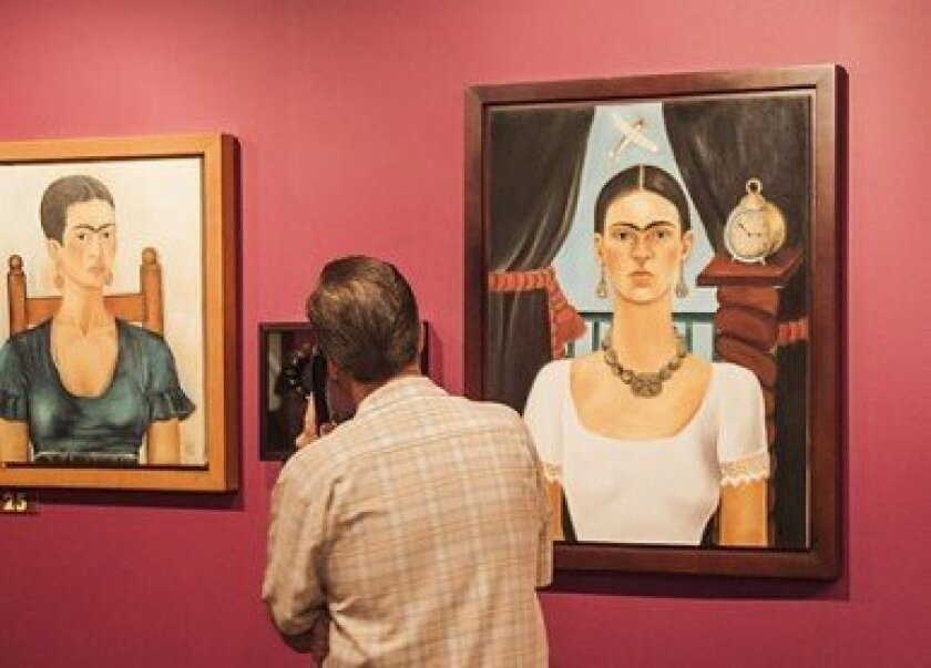 A visitor gets up close and personal with Frida.