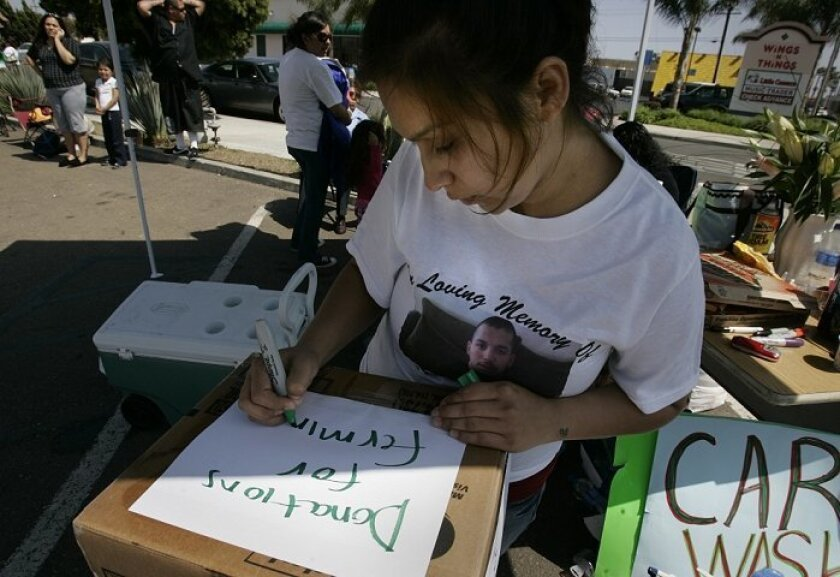 Amanda Sotelo sold T-shirts bearing the image of her 5-week-old son and boyfriend yesterday to raise money to help cover funeral  expenses. Her boyfriend, Fermin Garcia, was shot to death on Tuesday.