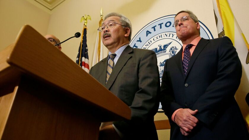 San Francisco Mayor Ed Lee, left, and City Atty. Dennis Herrera in January discuss the city's legal challenge to President Trump's executive order that would cut funding from municipal governments that refuse to aid federal immigration enforcement actions.