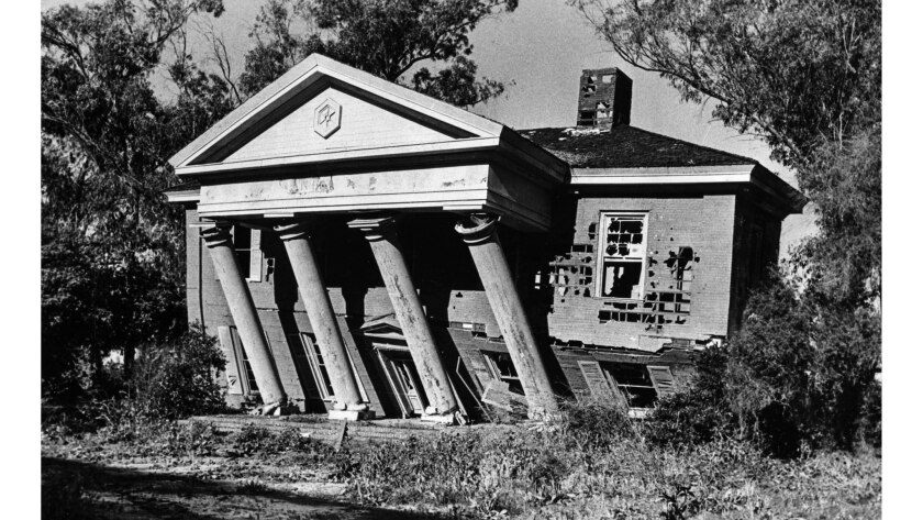 Feb. 21, 1978: A push from a tractor knocks down mansion at old MGM lot 2.