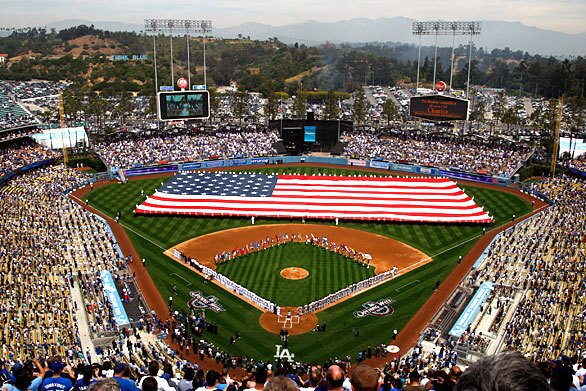 A giant American flag is unfurled across the outfield at Dodger Stadium before the home opener of the 2009 season. The Dodgers took on the San Francisco Giants.