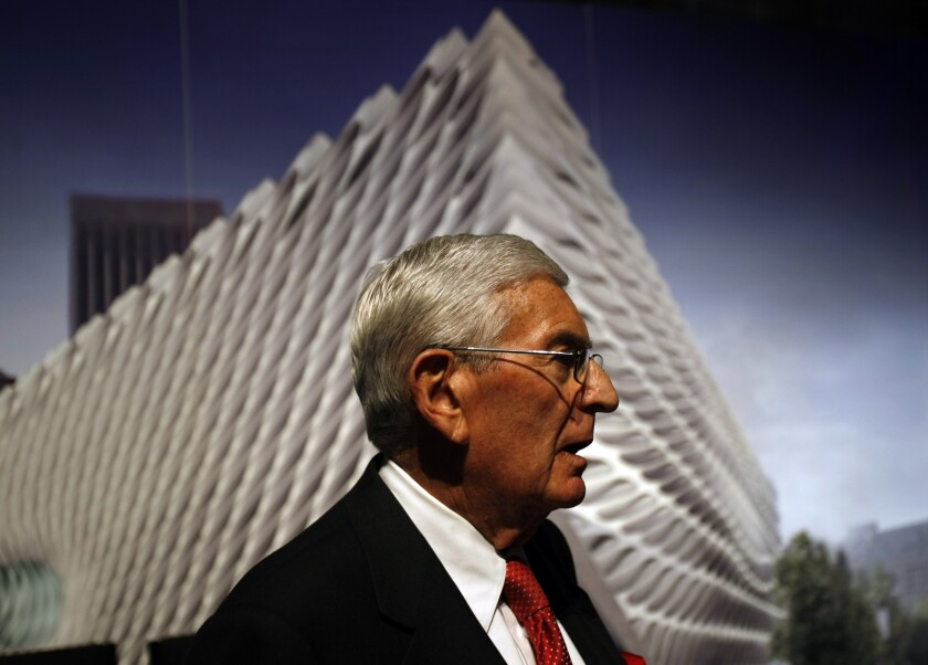 Eli Broad, in profile, against a rendering of the corner of the Broad museum