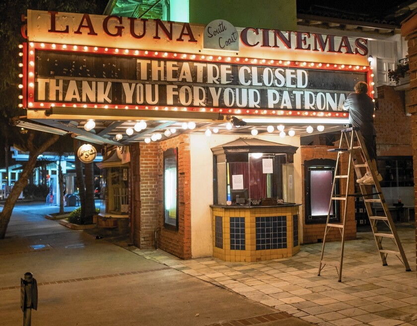 The final sign goes up at the Laguna South Coast Cinemas, which closed Sunday.