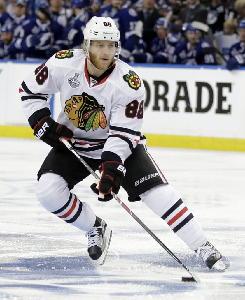 FILE - In this June 6, 2015, file photo, Chicago Blackhawks right wing Patrick Kane skates against the Tampa Bay Lightning during the second period in Game 2 of the NHL hockey Stanley Cup Final in Tampa, Fla. Prosecutors announced Thursday, Nov. 5, 2015, that they will not bring rape charges agains
