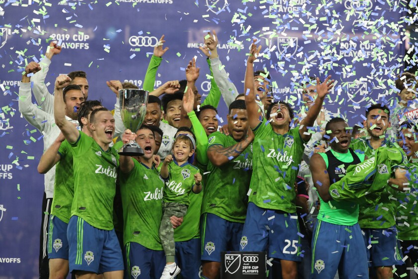 Seattle Sounders players celebrate their 3-1 victory over LAFC.