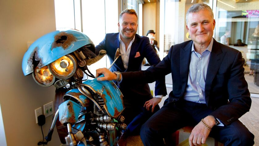 "Hasbro executives Simon Waters (Global Brand Licensing), Steve Davis (Chief Content Officer) and with SQUEAKS (a Vespa scooter), a new Transformer for the up coming ""Transformer"" movie"