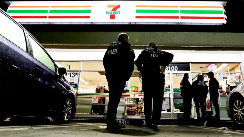 U.S. Immigration and Customs Enforcement agents serve an employment audit notice at a 7-Eleven store in Los Angeles on Jan. 10.