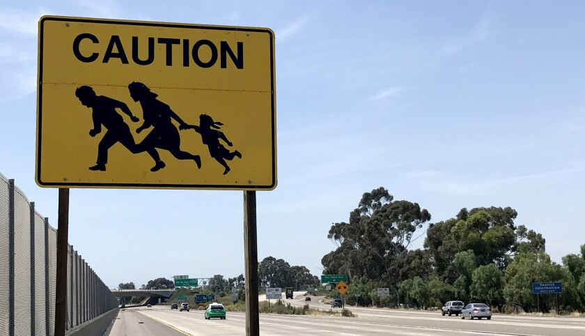 Immigrant crossing caution signs once dotted Interstate 5 in San Diego County. The last one vanished in 2017.