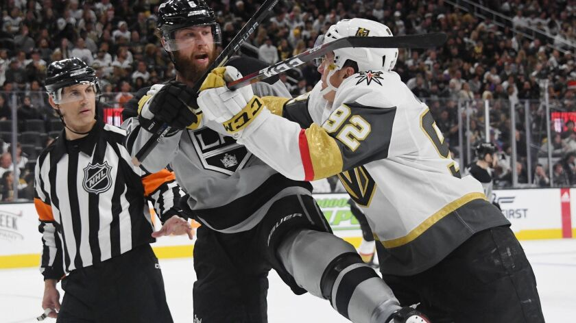 Vegas Golden Knights' Tomas Nosek, right, shoves Kings' Jake Muzzin in the second period on Dec. 23, 2018 in Las Vegas.