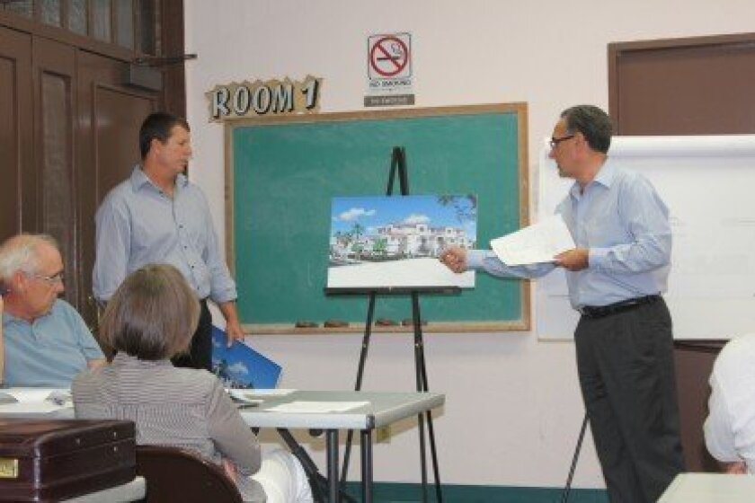 Land-use consultant Joe LaCava (right) shares details about a mixed-use project planned for the corner of Pearl Street and Eads Avenue (now a Unocal 76 gas station) during the Aug. 13 meeting of the Development Permit Review committee (architect Alex Faulkner looks on). LaCava is representing prope