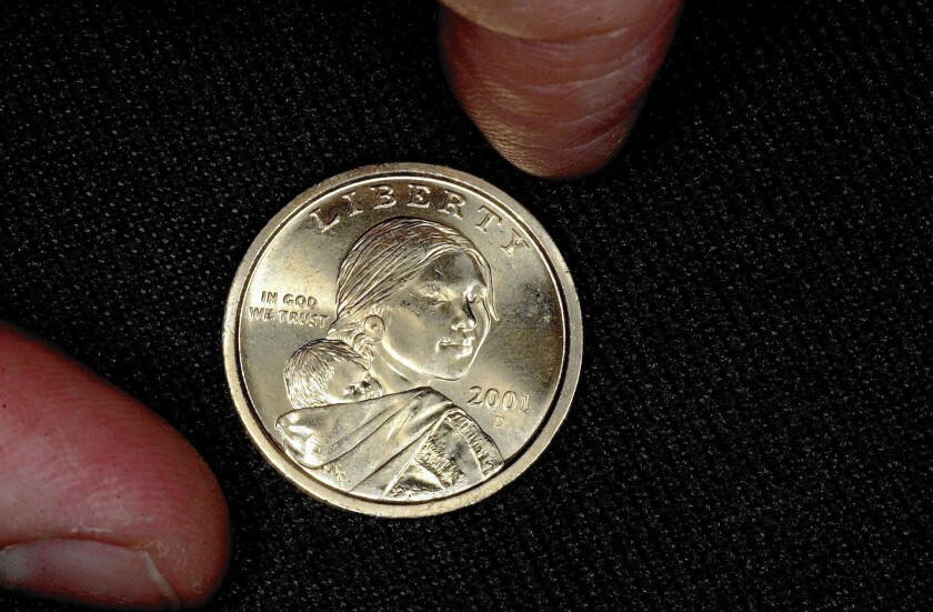 Shoshone guide Sacagawea was selected for the front of the gold dollar coin in a nod to the inclusion of Native Americans and women on the nation's currency.
