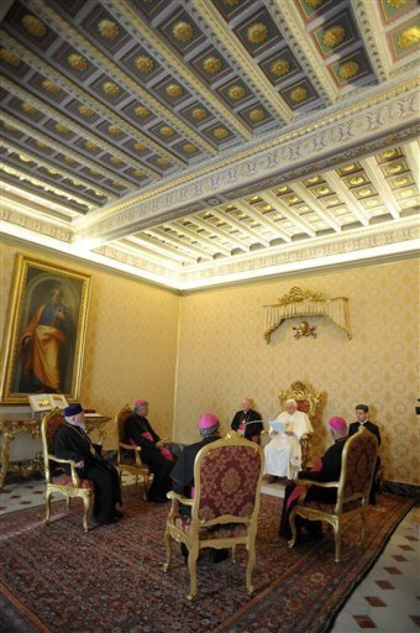 In this picture made available by the Vatican newspaper Osservatore Romano, Pope Benedict XVI meets with Iran's bishops at the Vatican, Friday, Jan. 16, 2009. The Pontiff has said that Iran should work for peace in the Middle East and urged Catholics in the country not to emigrate and to cooperate