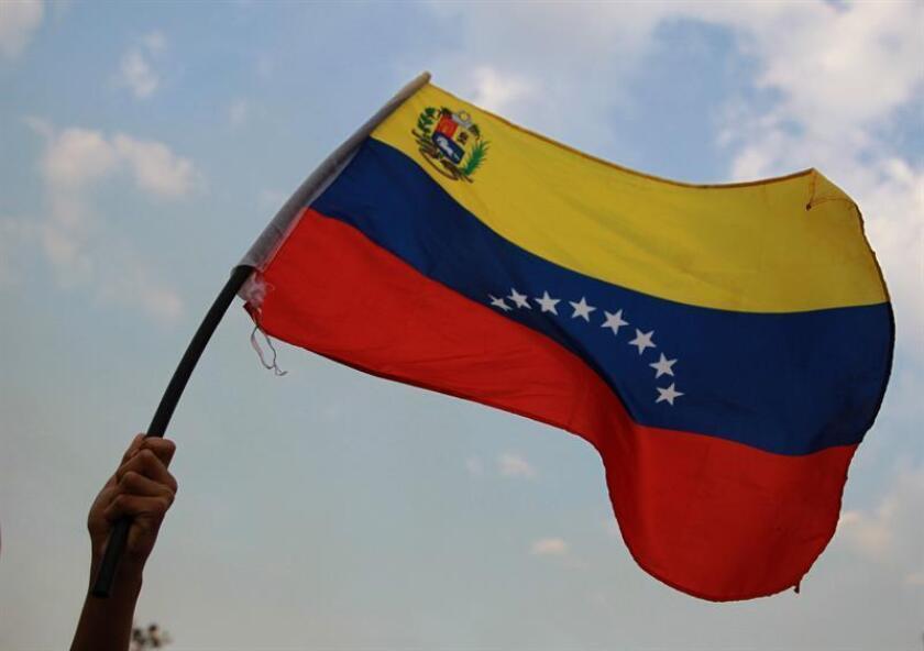 Ciudadanos venezolanos participan en una manifestación. EFE/Archivo