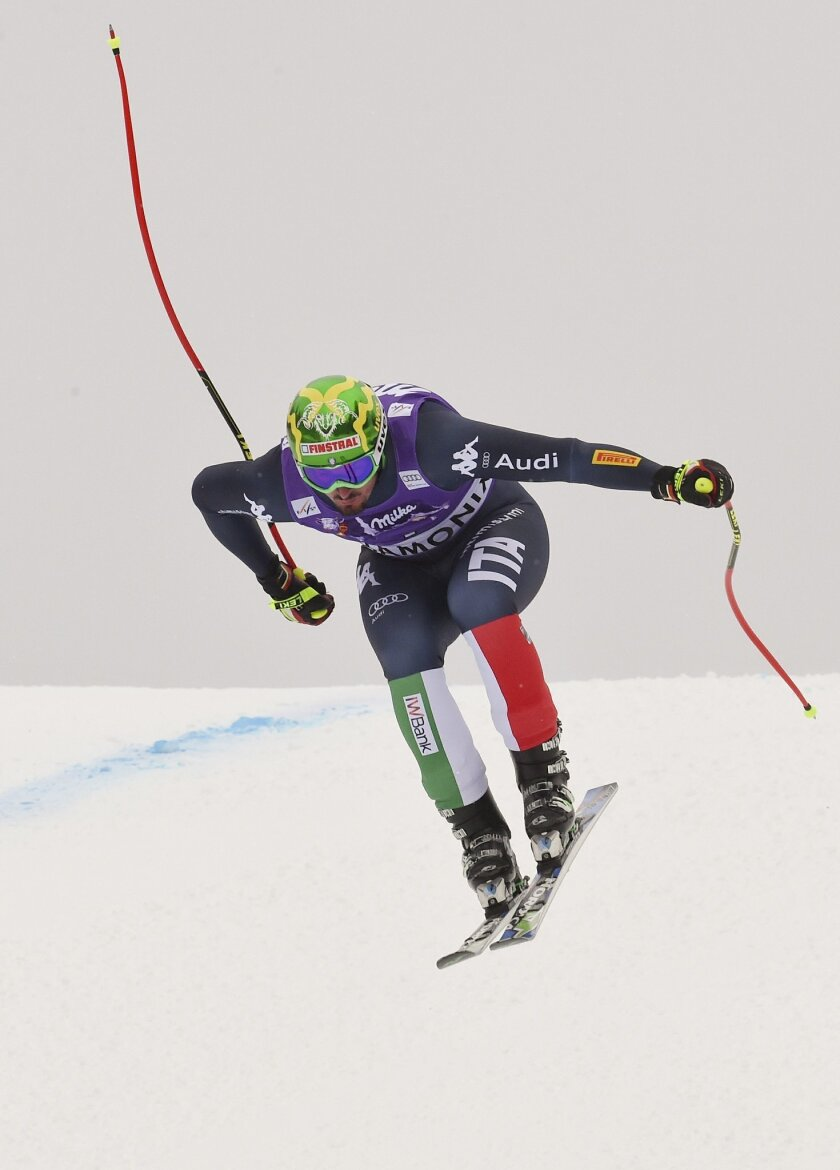 Italy's Dominik Paris races on his way to the second place, during the downhill portion of an alpine ski, men's World Cup combined race, in Chamonix, France, Friday, Feb. 19, 2016. (AP Photo/Pier Marco Tacca)