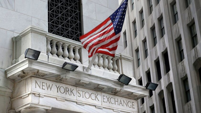 FILE - This Monday, Aug. 24, 2015, file photo shows the New York Stock Exchange. Stocks are opening