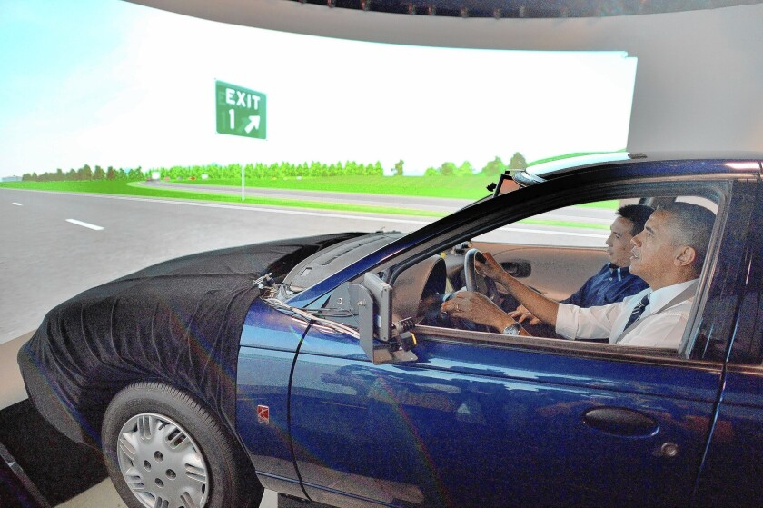President Obama drives an automobile simulator at the Turner-Fairbank Highway Research Center in McLean, Va.