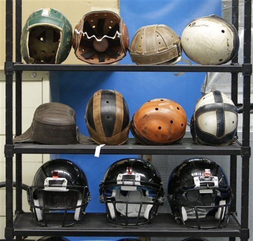 FILE - In this Sept. 23, 2010, file photo some football helmets used for testing helmet-to-helmet collisions are seen in a rack at a laboratory in the Cleveland Clinic's Lutheran Hospital. Sen. Tom Udall, D-N.M., and Rep. Bill Pascrell, D-N.J., introduced the Children's Sports Athletic Equipment Safety Act in March 2011. With sports concussions among the nation's young people a big issue in schools the bill would give the industry nine months to come up with new standards that address concussion risks and their specific needs. (AP Photo/Mark Duncan, File)