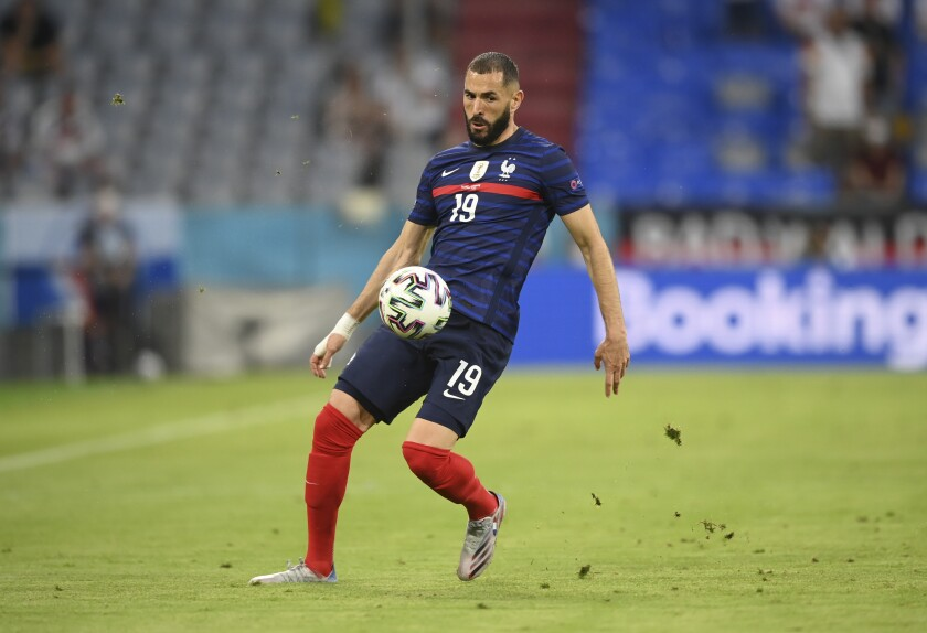 France's Karim Benzema controls the ball during the Euro 2020 soccer championship group F match between France and Germany at the Allianz Arena stadium in Munich, Tuesday, June 15, 2021. (Matthias Hangst/Pool via AP)
