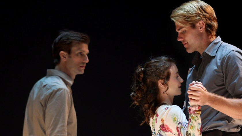 """Eddie (Frederick Weller) looks on as Catherine (Catherine Combs) is held by Rodolpho (Dave Register) in """"A View From the Bridge."""""""
