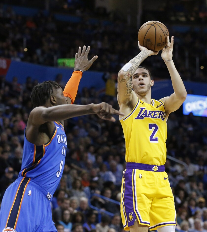 Lonzo Ball puts up a shot against Jerami Grant of the Thunder on Thursday.