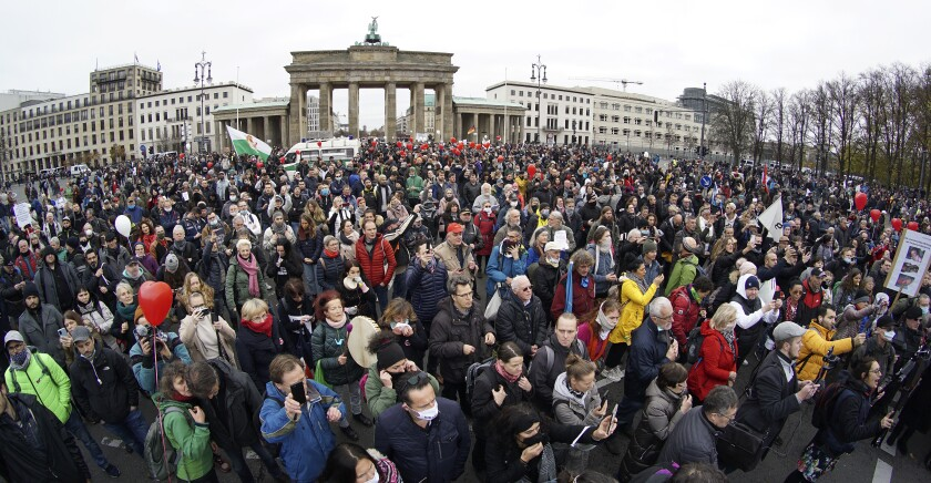 Protesters against coronavirus restrictions gather in front of the Brandenburg Gate in Berlin.
