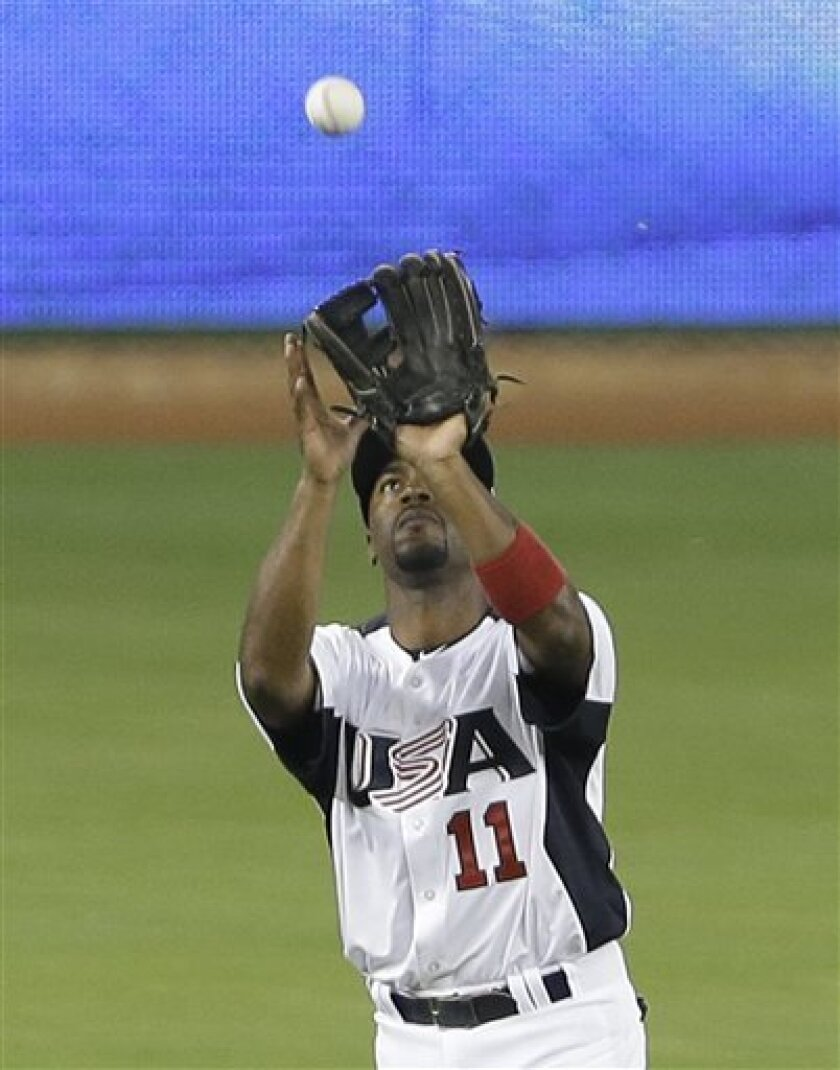 United States' Jimmy Rollins catches a ball hit by Puerto Rico's Alex Rios in the first inning of a second round World Baseball Classic game, Tuesday, March 12, 2013 in Miami. The U.S. defeated Puerto Rico 7-1. (AP Photo/Wilfredo Lee)