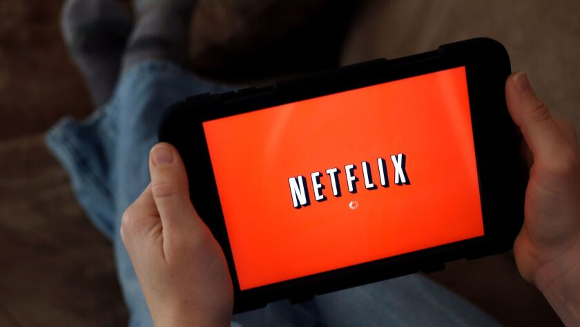 Netflix will start charging $11 a month instead of $10 for its most popular U.S. streaming plan.