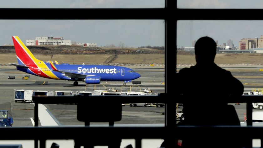 A Southwest Airlines jet taxis at LaGuardia Airport in New York. Southwest's CEO accuses mechanics of grounding planes for minor problems to gain leverage in labor negotiations, a claim the union denies.