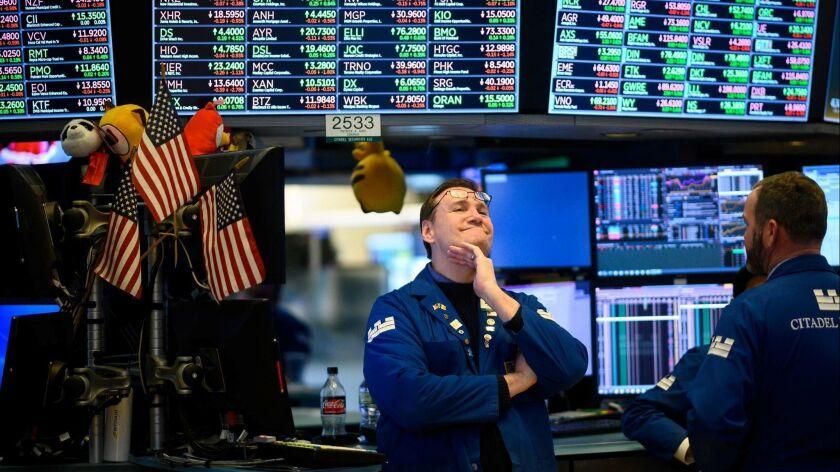 Traders work on the floor of the New York Stock Exchange on Feb. 1.