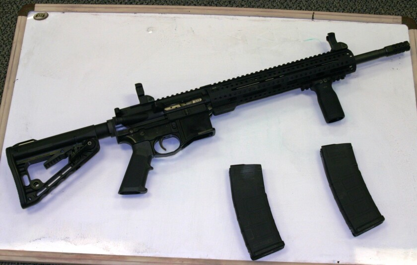 An assault rifle is among evidence from raids of suspected hash oil operations in San Diego County.